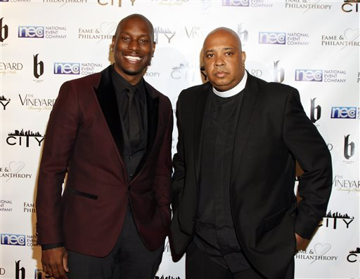 "FILE - In this March 2, 2014 file photo, Tyrese Gibson, left, and Joseph Simmons, better known as Rev Run pose at The Vineyard Beverly Hills  in Los Angeles. Oprah Winfrey's OWN network announced Thursday, June 11, 2015, that thepair will star in a prime-time series debuting early next year. It is based on the two friends' book, ""Man-ology,"" offering a male perspective on love and relationships. (Photo by Arnold Turner/Invision/AP, File)"