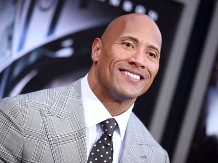 "FILE - In this May 26, 2015 file photo, Dwayne Johnson arrives at the premiere of ""San Andreas"" at the TCL Chinese Theatre in Los Angeles. While speaking to TV critics Thursday, July 30, 2015, about his HBO series ""Ballers,"" Johnson was asked to comment on the tape of Hulk Hogan making racist comments. Johnson, also a former pro wrestler, said he was ""disappointed"" when he heard about Hogan's remarks, but also said the comments didn't match his personal history with him. (Photo by Richard Shotwell/Invision/AP, File)"