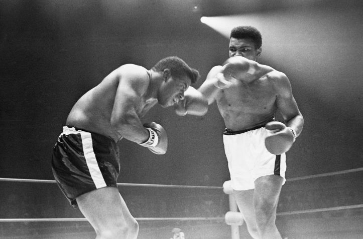 Muhammad Ali delivers a devastating blow to Floyd Patterson during the WBC Championship fight on November 22, 1965 in Las Vegas. Ali emerged victorious after a 12-round decision in his favor. (Herbert Nipson/Ebony Collection)