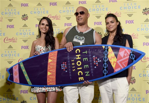 "Jordana Brewster, from left, Vin Diesel and Michelle Rodriguez pose in the press room with the choice movie action adventure award for ""Furious 7"" at the Teen Choice Awards at the Galen Center on Sunday, Aug. 16, 2015, in Los Angeles. (Photo by Chris Pizzello/Invision/AP)"