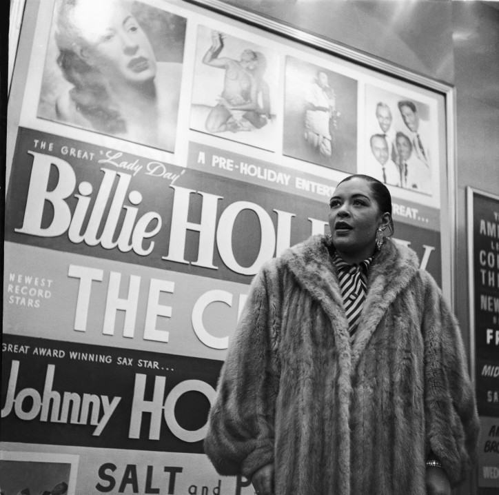 Lady Day herself, Billie Holiday, is photographed in front of a large billboard advertising her name in this undated photo. (Moneta Sleet, Jr./Ebony Collection)