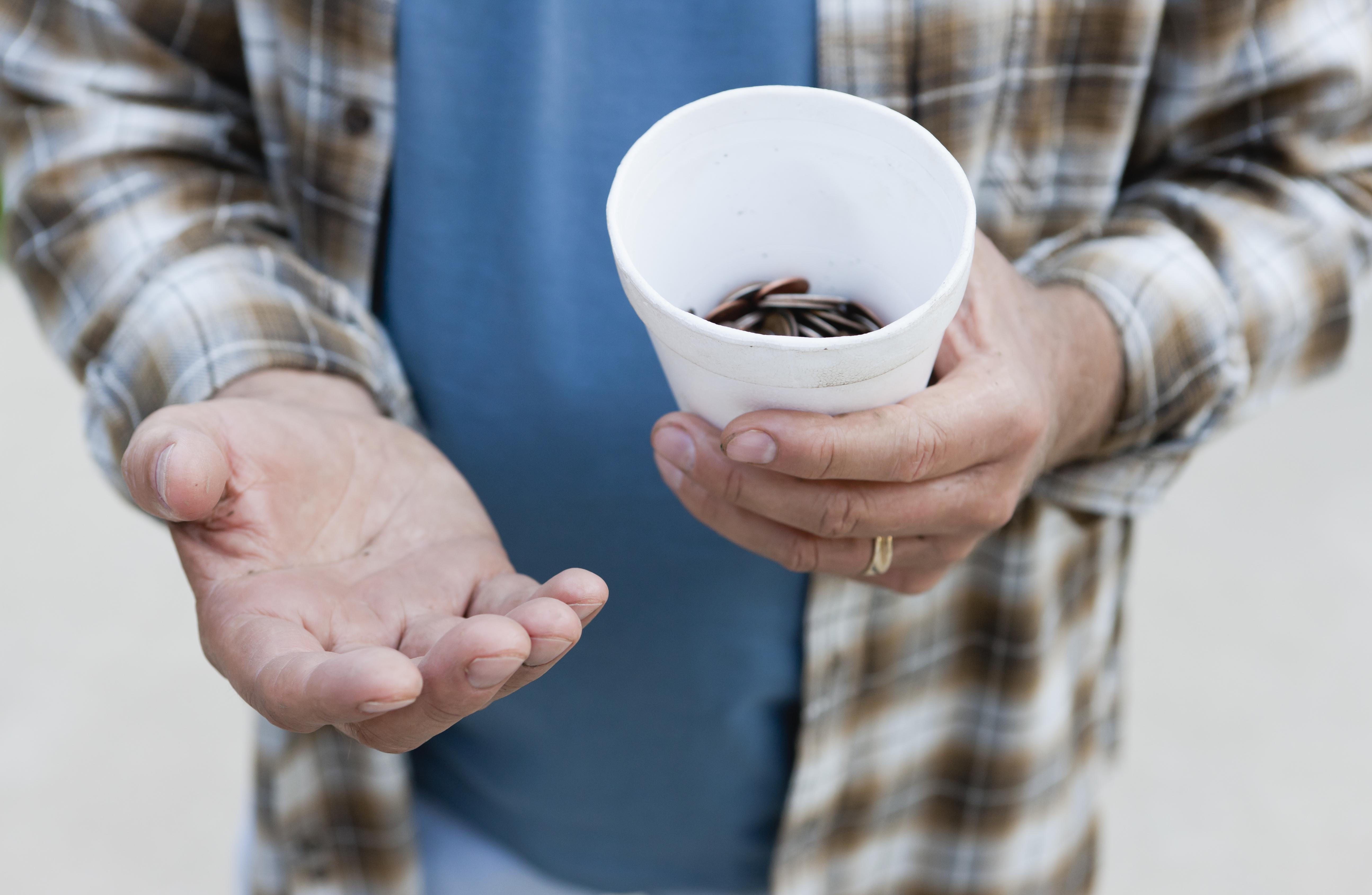 USA, Illinois, Metamora, Close-up of man begging for money