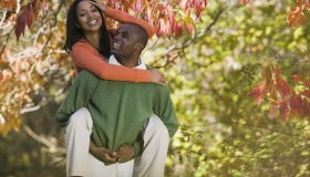 Playful couple among autumn leaves