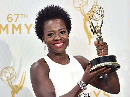 """Viola Davis poses in the press room with the award for outstanding lead actress in a drama series for """"How to Get Away With Murder"""" at the 67th Primetime Emmy Awards on Sunday, Sept. 20, 2015, at the Microsoft Theater in Los Angeles. (Photo by Jordan Strauss/Invision/AP)"""
