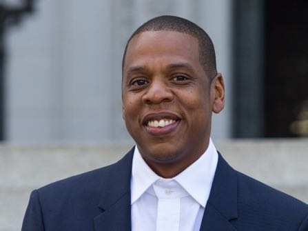 "FILE - In this April 16, 2014 file photo, Shawn ""Jay Z"" Carter announces the Made in America Festival from the steps of City Hall in Los Angeles. Testimony in a copyright infringement trial filed by the heir  of an Egyptian composer against Jay Z over his 1999 hit ""Big Pimpin'"" concluded in Los Angeles on Tuesday, Oct. 20, 2015.  (Photo by Paul A. Hebert/Invision/AP, File)"