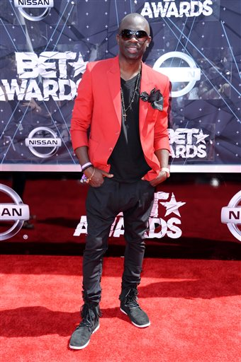 FILE - In this June 28, 2015 file photo, Sam Sarpong arrives at the BET Awards at the Microsoft Theater, in Los Angeles. The London-born model and TV actor Sarpong has died in Southern California after jumping to his death from a bridge. Sarpong, who was 40, died Monday afternoon, Oct. 26, 2015, in Pasadena, where he lived. (Photo by Richard Shotwell/Invision/AP, File)