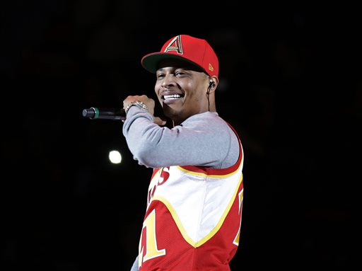 """FILE - In this Nov. 1, 2014, file photo, rapper T.I. performs before the start of an NBA basketball game between the Indiana Pacers and the Atlanta Hawks in Atlanta. T.I. has changed his stage name to his childhood name of Tip, and with his new EP """"Da' Nic,"""" he's gone independent, breaking away from a label for the first time. (AP Photo/David Goldman, File)"""