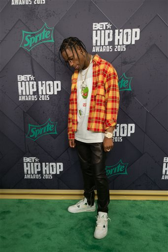 Travis Scott poses for a photo at the 2015 BET Hip Hop Awards, Friday, Oct. 9, 2015, at the Atlanta Civic Center in Atlanta.  (AP Photo/Branden Camp)