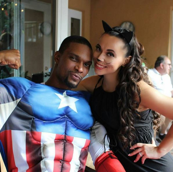 Chris Bosh as Captain America and wife Adrienne as Catwoman