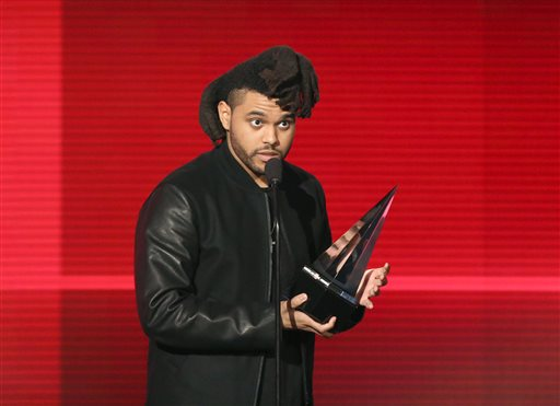 The Weeknd accepts award for best soul/R&B male artist at the American Music Awards at the Microsoft Theater on Sunday, Nov. 22, 2015, in Los Angeles. (Photo by Matt Sayles/Invision/AP)
