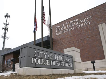 FILE - This March 4, 2015, file photo, shows the entrance to the Ferguson, Mo., Police Department. The Justice Department is close to an agreement with the Ferguson, Missouri, police department on a deal that would bring sweeping changes to the agency, a person familiar with the matter said Wednesday, Dec. 16. (AP Photo/Charles Rex Arbogast, File)