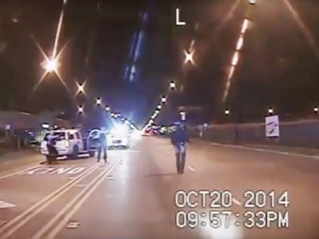FILE - In this Oct. 20, 2014 frame from dash-cam video provided by the Chicago Police Department, Laquan McDonald, right, walks down the street moments before being shot by officer Jason Van Dyke in Chicago. Van Dyke, who shot McDonald 16 times, was charged with first-degree murder Tuesday, Nov. 24, 2015. The video has no sound, nor do videos from four other squad cars at the scene. But police protocol indicates that all the cruisers should have been recording audio that night. (Chicago Police Department via AP, File)