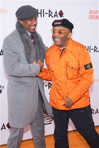 "Nick Cannon, left, and Spike Lee attend the premiere of ""Chi-Raq"" at the Ziegfeld Theatre on Tuesday, Dec. 1, 2015, in New York. (Photo by Charles Sykes/Invision/AP)"