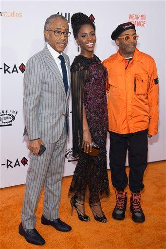 "Al Sharpton, from left,  Teyonah Parris and Spike Lee attend the premiere of ""Chi-Raq"" at the Ziegfeld Theatre on Tuesday, Dec. 1, 2015, in New York. (Photo by Charles Sykes/Invision/AP)"