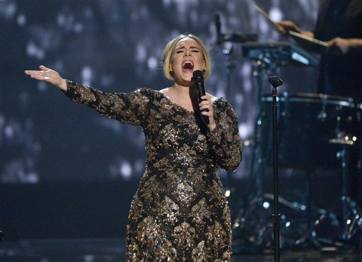 FILE - In this Nov. 17, 2015 image released by NBC, Adele performs at Radio City Music Hall in New York. The Recording Academy announced Wednesday, Jan. 20, 2016, that Adele, leading nominee Kendrick Lamar, the Weeknd and Little Big Town will perform at the Grammy Awards on Feb. 15. Adele, who has won 10 Grammys, will qualify for nominations at next year's awards show because she released music after the Sept. 30, 2015 deadline. (Virginia Sherwood/NBC via AP)