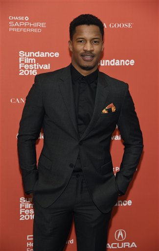 """Nate Parker, the director, star and producer of """"The Birth of a Nation,"""" poses at the premiere of the film at the 2016 Sundance Film Festival on Monday, Jan. 25, 2016, in Park City, Utah. (Photo by Chris Pizzello/Invision/AP)"""