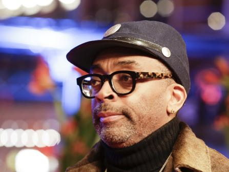"""FILE - In this Feb. 16, 2016 file photo, director Spike Lee poses for the photographers at the 2016 Berlinale Film Festival in Berlin, Germany. Lee is endorsing Bernie Sanders for president in a South Carolina radio ad. Arguing, in Sanders' words, that the """"system is rigged,"""" Lee praises Sanders for not taking money from corporations in the ad. And in a reference to one of his early films, Lee says that once in the White House, Sanders will """"do the right thing."""" (AP Photo/Markus Schreiber, File)"""