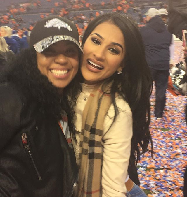 Aqib Talib's girlfriend and Emmanuel Sanders' wife cheering on the Denver Broncos.