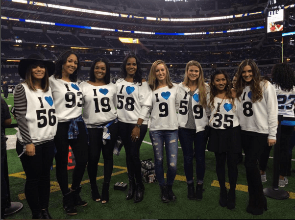 A group pic of the Panthers WAG's at a game