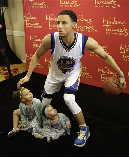 Riley Curry left, and her sister Ryan, look up at a wax figure of their father, Golden State Warriors guard Stephen Curry, after its unveiling by Madame Tussauds Thursday, March 24, 2016, in Oakland, Calif. The figure of the NBA MVP will go on display at Madame Tussauds wax museum at Fisherman's Wharf in San Francisco. (AP Photo/Eric Risberg)