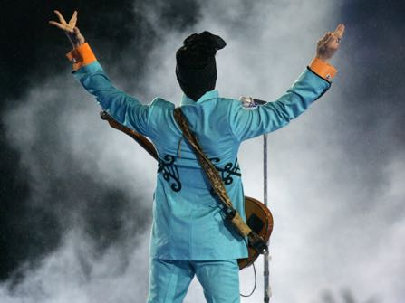 FILE - In this Feb. 4, 2007 file photo, Prince performs during the halftime show at Super Bowl XLI at Dolphin Stadium in Miami. Prince's publicist has confirmed that Prince died at his home in Minnesota, Thursday, April 21, 2016. He was 57. (AP Photo/Chris Carlson, File)