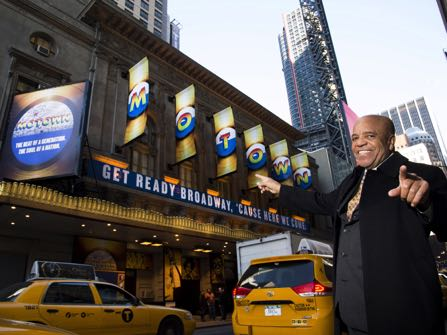 "FILE - This March 5, 2013 file photo shows Berry Gordy posing for a portrait in front of the Lunt-Fontanne Theatre where ""Motown: The Musical,"" opened on Broadway in New York. The hit musical about Gordy is coming back to Broadway this summer for an 18-week stand at the Nederlander Theatre. (Photo by Charles Sykes/Invision/AP, File)"