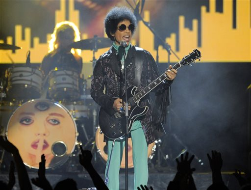 """FILE - In this May 19, 2013 file photo, Prince performs at the Billboard Music Awards at the MGM Grand Garden Arena in Las Vegas. Prince, widely acclaimed as one of the most inventive and influential musicians of his era with hits including """"Little Red Corvette,"""" ''Let's Go Crazy"""" and """"When Doves Cry,"""" was found dead at his home on Thursday, April 21, 2016, in suburban Minneapolis, according to his publicist. He was 57. (Photo by Chris Pizzello/Invision/AP, File)"""