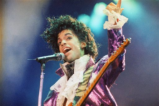"""FILE - In this Feb. 18, 1985 file photo, Prince performs at the Forum in Inglewood, Calif. Prince, widely acclaimed as one of the most inventive and influential musicians of his era with hits including """"Little Red Corvette,"""" ''Let's Go Crazy"""" and """"When Doves Cry,"""" was found dead at his home on Thursday, April 21, 2016, in suburban Minneapolis, according to his publicist. He was 57. (AP Photo/Liu Heung Shing, File)"""