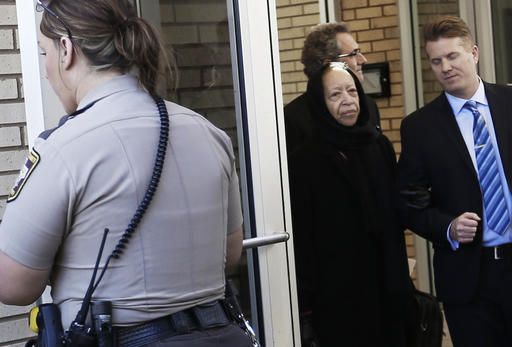 A deputy holds the door as Noreen Nelson, center, the half-sister of Prince, leaves the Carver County Courthouse Monday, May 2, 2016, in Chaska, Minn. where a judge has confirmed the appointment of a special administrator to oversee the settlement of Prince's estate. The pop rock singer died on April 21 at the age of 57. (AP Photo/Jim Mone)