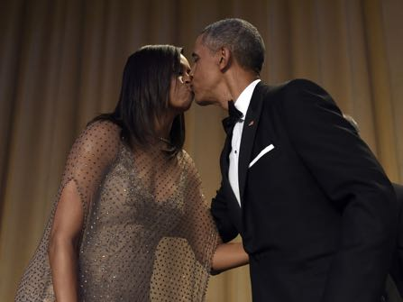 President Barack Obama, right, kisses first lady Michelle Obama, left, after he spoke at the annual White House Correspondents' Association dinner at the Washington Hilton in Washington, Saturday, April 30, 2016. (AP Photo/Susan Walsh)