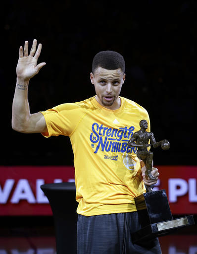 Golden State Warriors' Stephen Curry waves to the crowd after receiving the NBA Most Valuable Player award before Game 5 of the team's second-round NBA basketball playoff series against the Portland Trail Blazers on Wednesday, May 11, 2016, in Oakland, Calif. (AP Photo/Marcio Jose Sanchez)