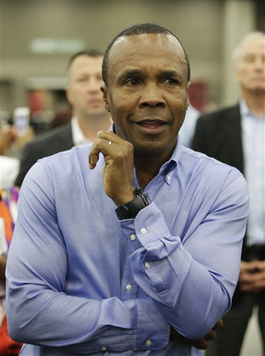 Former boxing champion Sugar Ray Leonard arrives for Muhammad Ali's Jenazah, a traditional Islamic Muslim service, in Freedom Hall, Thursday, June 9, 2016, in Louisville, Ky. (AP Photo/Darron Cummings)