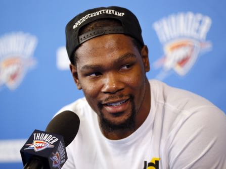"Oklahoma City's Kevin Durant (35) speaks during a news conference at the team's practice facility in Oklahoma City, Wednesday, June 1, 2016. Durant, the face of the Oklahoma City franchise since its move from Seattle in 2008 is heading into free agency, and what he chooses to do could shake up the NBA landscape. Durant said Wednesday that he has not yet ""wrapped"" his mind around the idea of being a free agent. (Nate Billings/The Oklahoman via AP) LOCAL STATIONS OUT (KFOR, KOCO, KWTV, KOKH, KAUT OUT); LOCAL WEBSITES OUT; LOCAL PRINT OUT (EDMOND SUN OUT, OKLAHOMA GAZETTE OUT) TABLOIDS OUT; MANDATORY CREDIT"