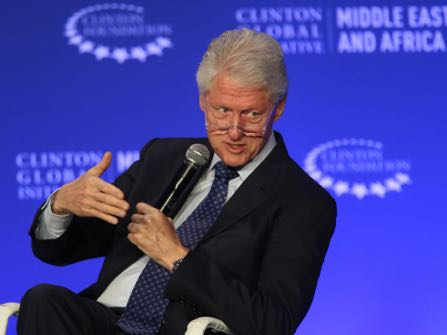 FILE - In this May 6, 2015, photo, former President Bill Clinton speaks during a plenary session at the Clinton Global Initiative Middle East & Africa meeting in Marrakech, Morocco. As Bill Clinton's presidency ended, he was popular, yet still tainted by scandal, and struggling to find his footing after eight years in the White House. He eventually channeled his energy into the global philanthropy that bears his name and has shaped so much of his post-presidential legacy. (AP Photo/Abdeljalil Bounhar, File)