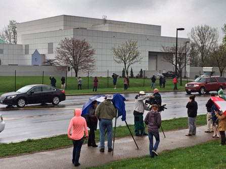 FILE - In this April 21, 2016 file photo, people stand outside the entertainer Prince's Paisley Park compound in Chanhassen, Minn. Paisley Park, the private estate and production complex of the late rock superstar Prince, will open for public tours starting Oct. 6. (Jim Gehrz/Star Tribune via AP, File)