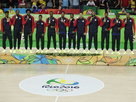 The United States' team poses with their gold medals for men's basketball at the 2016 Summer Olympics in Rio de Janeiro, Brazil, Sunday, Aug. 21, 2016. (AP Photo/Charlie Neibergall)