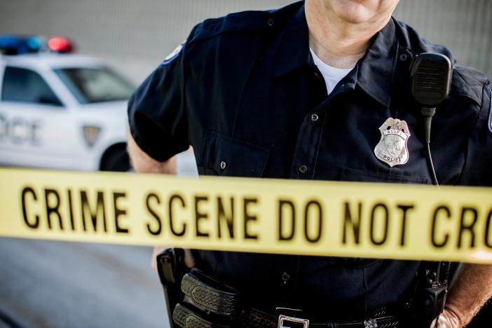 Police Detective at Crime Scene