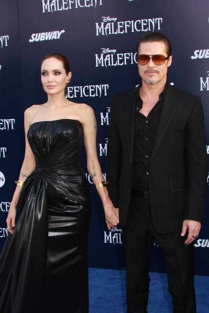 "05/28/2014 - Angelina Jolie and Brad Pitt - World Premiere Of Disney's ""Maleficent"" - Arrivals - El Capitan Theatre - Hollywood, CA, USA - Keywords: Orientation: Portrait Face Count: 1 - False - Photo Credit: Kazuki Hirata / HollywoodNewsWire.net / PRPhotos.com - Contact (1-866-551-7827) - Portrait Face Count: 1"