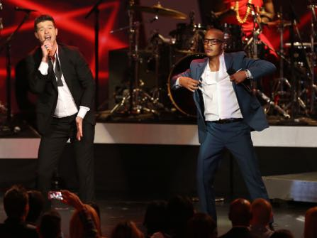 "FILE- In this Dec. 6, 2013, file photo, Robin Thicke, left, and T.I. perform ""Blurred Lines"" at the Grammy Nominations Concert Live! at the Nokia Theatre L.A. Live in Los Angeles. More than 200 musicians filed a brief with the Ninth Circuit Court of Appeals on Tuesday, Aug. 30, 2016, to express concern about the ruling last year in a case brought by the children of Marvin Gaye, who sued for copyright infringement claiming ""Blurred Lines"" copied Gaye's hit ""Got to Give it Up."" (Photo by Matt Sayles/Invision/AP, File)"