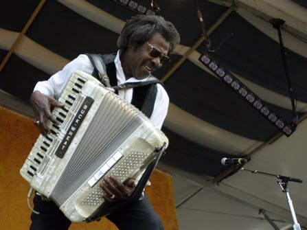 "FILE - In this May 5, 2007 file photo, Buckwheat Zydeco performs during the 2007 Jazz and Heritage Festival in New Orleans. Stanley ""Buckwheat"" Dural Jr., who introduced zydeco music to the world through his namesake band Buckwheat Zydeco, has died. He was 68. His longtime manager Ted Fox told The Associated Press that Dural died early Saturday, Sept. 24, 2016. He had suffered from lung cancer.(AP Photo/Dave Martin)"