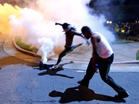 Protesters demonstrate in Charlotte, N.C., Tuesday, Sept. 20, 2016. Authorities used tear gas to disperse protesters in an overnight demonstration that broke out Tuesday after Keith Lamont Scott was fatally shot by an officer at an apartment complex. (Jeff Siner/The Charlotte Observer via AP)
