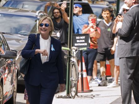 Democratic presidential candidate Hillary Clinton walks from her daughter Chelsea's apartment building Sunday, Sept. 11, 2016, in New York. (AP Photo/Craig Ruttle)