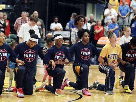 Members of the Indiana Fever kneel during the playing of the national anthem before the start of of a first round WNBA playoff basketball game, against the Phoenix Mercury, Wednesday, Sept. 21, 2016, in Indianapolis. (AP Photo/Darron Cummings)