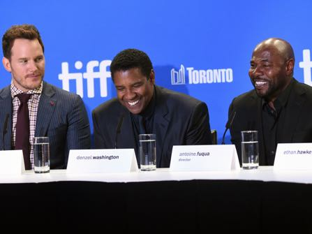 """Chris Pratt, from left, Denzel Washington and Antoine Fuqua participate in """"The Magnificent Seven"""" press conference on day 1 of the Toronto International Film Festival at the TIFF Bell Lightbox on Thursday, Sept. 8, 2016, in Toronto. (Photo by Evan Agostini/Invision/AP)"""