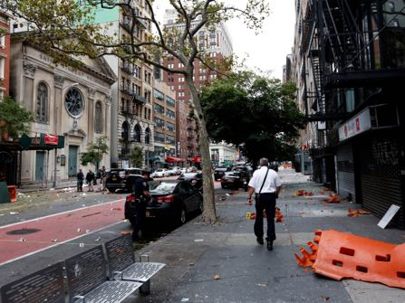 A view the street Sunday, Sept. 18, 2016, at the site of an explosion that occurred on Saturday night in the Chelsea neighborhood of New York. Numerous people were injured in blast, and the motive, while reportedly not international terrorism, is still being investigated. (Justin Lane/EPA via AP, Pool)