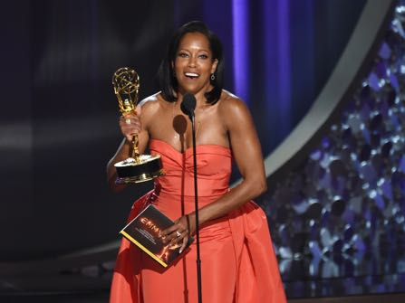 """Regina King accepts the award for outstanding supporting actress in a limited series or movie for """"American Crime"""" at the 68th Primetime Emmy Awards on Sunday, Sept. 18, 2016, at the Microsoft Theater in Los Angeles. (Photo by Chris Pizzello/Invision/AP)"""