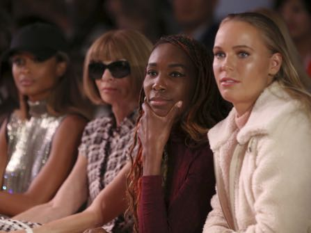 Caroline Wozniacki, from right, Venus Williams and Anna Wintour watch as the Serena Williams Signature Statement Spring 2017 collection is modeled during Fashion Week in New York, Monday, Sept. 12, 2016. (AP Photo/Seth Wenig)