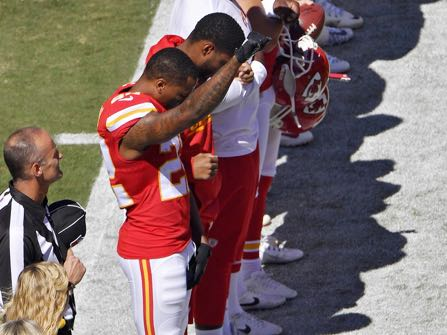 Kansas City Chiefs defensive back Marcus Peters raises his fist in the air as the national anthem plays before Sunday's football game against the San Diego Chargers on Sunday, Sept. 11, 2016, in Kansas City, Mo. (John Sleezer/The Kansas City Star via AP)