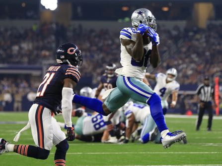 FILE - In this Sept. 25, 2016, file photo, Chicago Bears cornerback Tracy Porter (21) defends as Dallas Cowboys wide receiver Dez Bryant (88) catches a pass thrown by Dak Prescott (4) for a touchdown during the second half of an NFL football game in Arlington, Texas. Bryant has a slight hairline fracture in a bone in his right knee, though coach Jason Garrett says the receiver might not miss a game. Bryant didn't practice Wednesday, three days after getting hurt in a win over Chicago, and the same day the team got back results of an MRI. (AP Photo/Ron Jenkins, File)