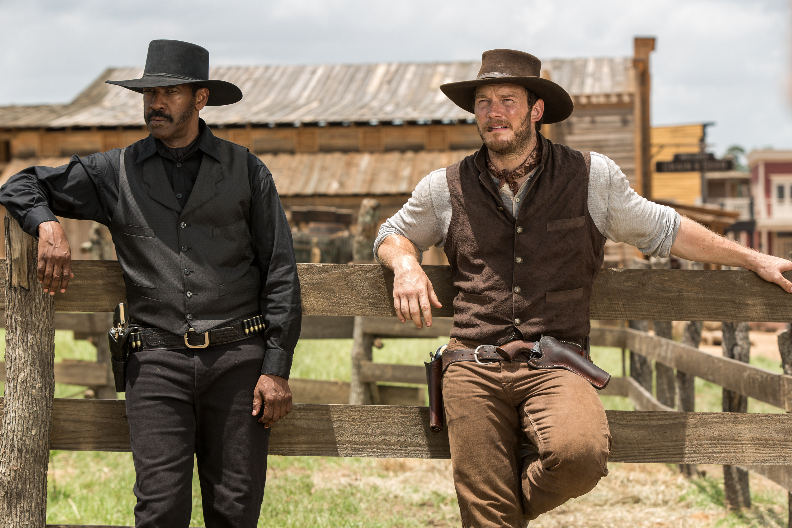 "In this image released by Sony Pictures, Chris Pratt, right, and Denzel Washington appear in a scene from ""The Magnificent Seven."" Antoine Fuqua's ""The Magnificent Seven"" remake rode the star power of Denzel Washington to an estimated $35 million debut, topping North American ticket sales over the weekend. (Sam Emerson/Sony Pictures via AP)"